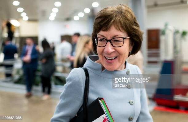 Sen. Susan Collins, R-Maine, speaks with a reporter in the Senate subway on Thursday, March 12, 2020.