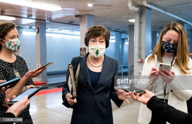 Sen. Susan Collins, R-Maine, speaks with reporters in the Senate subway after a vote in the Capitol on Tuesday, Jan. 26, 2021.