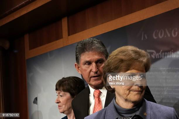 US Sen Susan Collins Sen Joe Manchin and Sen Jeanne Shaheen listen during a news conference February 15 2018 at the Capitol in Washington DC The...