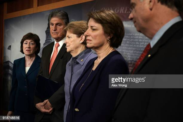 US Sen Susan Collins Sen Joe Manchin Sen Jeanne Shaheen and Sen Amy Klobuchar listen during a news conference February 15 2018 at the Capitol in...