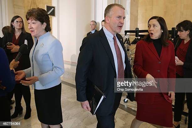 Sen Susan Collins Sen Thom Tillis and Sen Maria Cantwell leave a Senate bipartisan lunch in the Russell Senate Office Building on Capitol Hill...