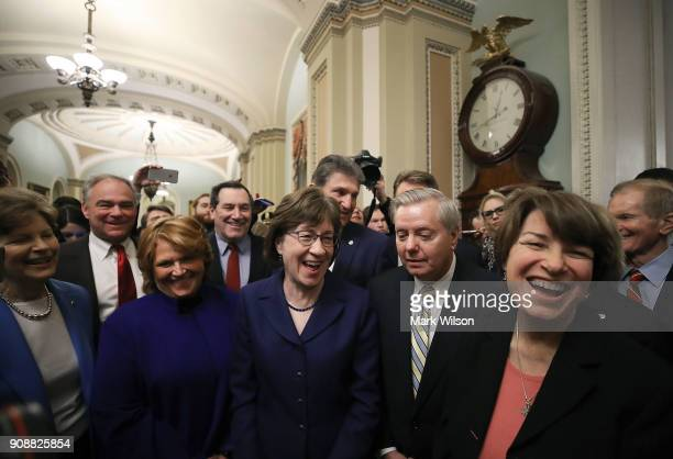 Sen Susan Collins stands with Sen Lindsey Graham and other fellow Senators after the Senate voted and passed the CR to reopen the government at the...