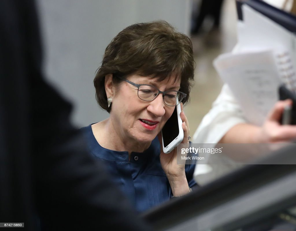 Sen. Susan Collins (R-ME) talks on her phone before attending the Senate GOP policy luncheon, at US Capitol on November 14, 2017 in Washington, DC.