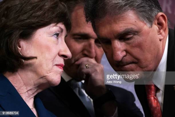 Sen. Susan Collins talks to Sen. Joe Manchin as Sen. Jeff Flake looks on during a news conference February 15, 2018 at the Capitol in Washington, DC....