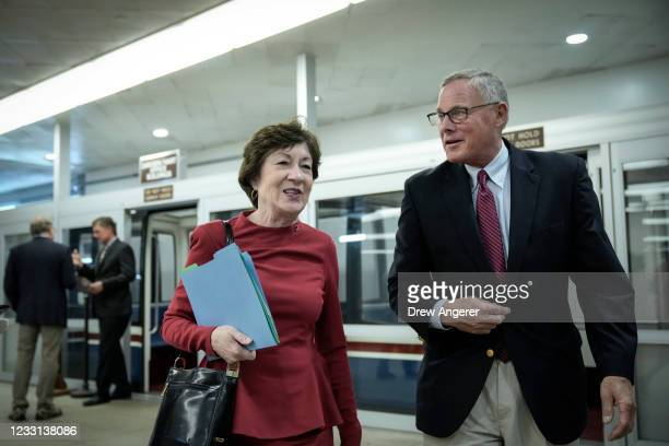 Sen. Susan Collins talks with Sen. Richard Burr as they walk through the Senate subway on their way to a vote at the U.S. Capitol May 27, 2021 in...