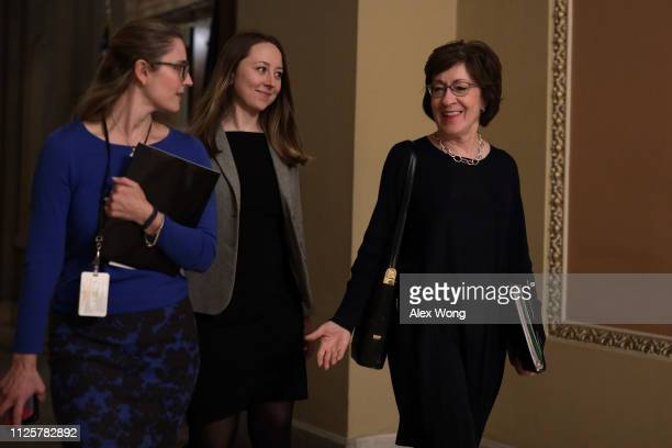Sen. Susan Collins walks in a hallway with aides at the U.S. Capitol January 28, 2019 in Washington, DC. After President Trump reopened the...