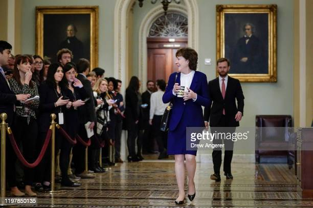 Sen. Susan Collins walks past the press as she leaves the Senate chamber during a recess in the Senate impeachment trial of U.S. President Donald...
