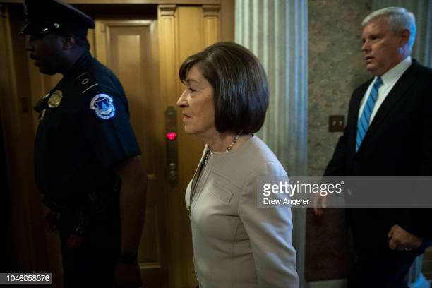 Sen. Susan Collins walks to the Senate floor for a cloture vote on the nomination of Supreme Court Judge Brett Kavanaugh to the U.S. Supreme Court,...
