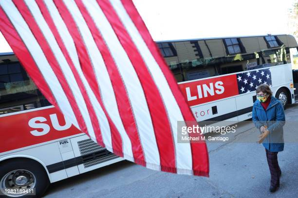 Sen. Susan Collins walks towards Bob's Farm, Home & Garden after leaving her campaign bus on October 31, 2020 in Dover-Foxcroft, Maine. According to...