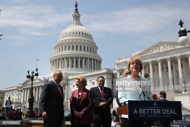 Sen Tammy Baldwin speaks alongside fellow Democrats Senate Minority Leader Charles Schumer Sen Debbie Stabenow and Sen Joe Donnelly during an event...