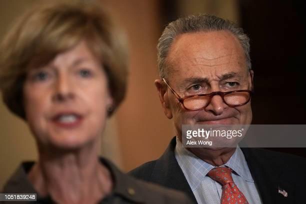 S Sen Tammy Baldwin speaks as Senate Minority Leader Sen Chuck Schumer listens during a news briefing after a weekly Senate Democratic policy...