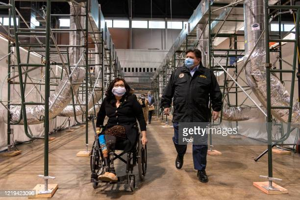 Sen. Tammy Duckworth and Illinois Gov. J.B. Pritzker tour the COVID-19 alternate care facility constructed at the McCormick Place convention center...