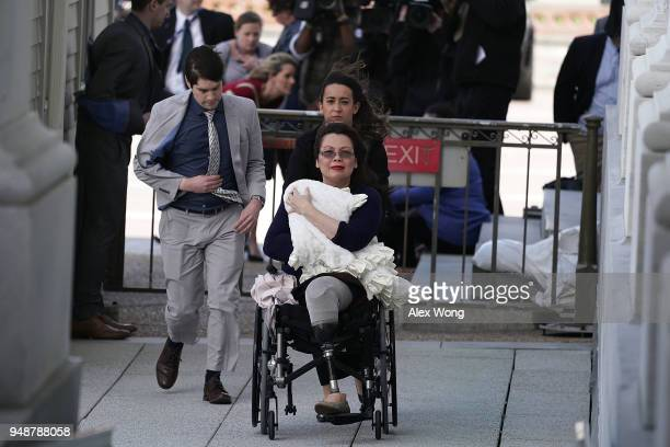 S Sen Tammy Duckworth arrives at the US Capitol with her newborn baby daughter Maile Pearl Bowlsbey for a vote on the Senate floor April 19 2018 on...