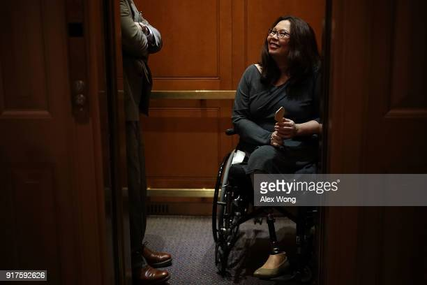 S Sen Tammy Duckworth leaves on an elevator after a vote at the Capitol February 12 2018 in Washington DC The Senate has passed a procedural vote...
