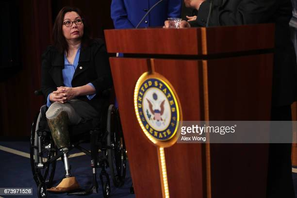 S Sen Tammy Duckworth listens during a news conference at the Capitol April 27 2017 in Washington DC Congressional Democrats held a news conference...