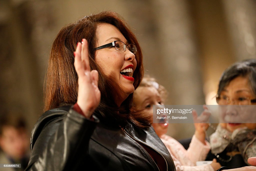 U.S. Sen. Tammy Duckworth (D-IL) participates in a reenacted swearing-in with U.S. Vice President Joe Biden in the Old Senate Chamber at the U.S. Capitol January 3, 2017 in Washington, DC. Earlier in the day Biden swore in the newly elected and returning members on the Senate floor.