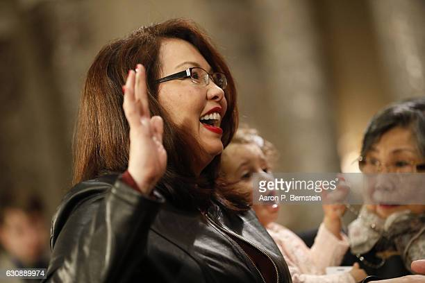 S Sen Tammy Duckworth participates in a reenacted swearingin with US Vice President Joe Biden in the Old Senate Chamber at the US Capitol January 3...
