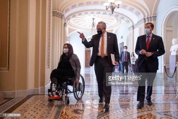 Sen. Tammy Duckworth , Senate Majority Leader Charles Schumer and Sen. Richard Blumenthal walk to a news conference following the passage of the...