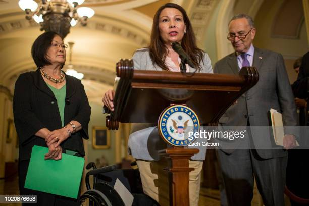 Sen Tammy Duckworth speaks during a weekly news conference on Capitol Hill on August 21 2018 in Washington DC Also pictured are Sen Mazie Hirono and...