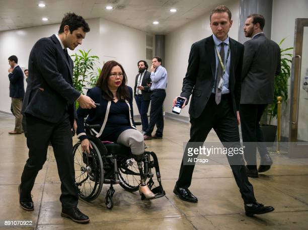 S Sen Tammy Duckworth speaks with reporters as she arrives for the weekly Senate Democrat's policy luncheon on Capitol Hill December 12 2017 in...
