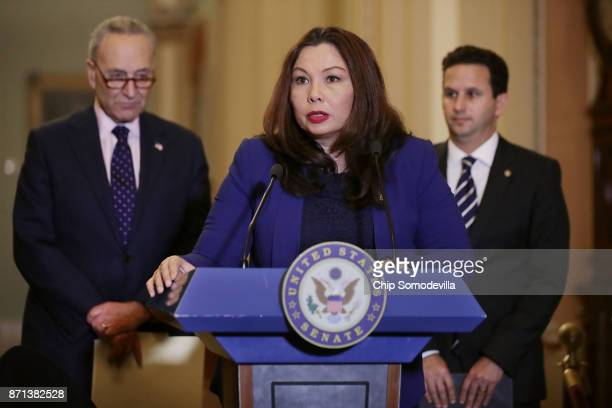 Sen Tammy Duckworth talks to reporters with Senate Minority Leader Charles Schumer and Sen Brian Schatz following the weekly Democratic policy...