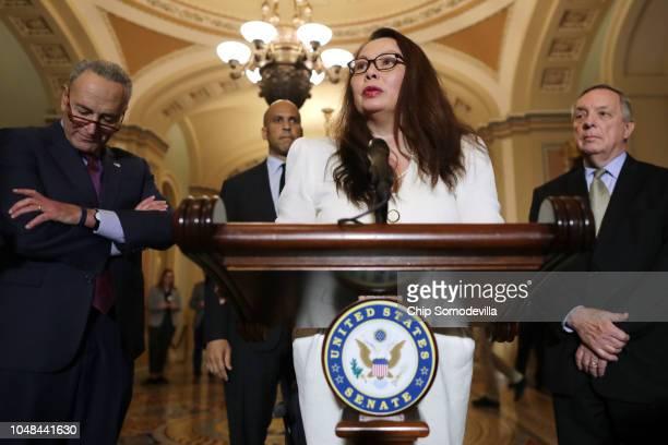 Sen Tammy Duckworth talks with reporters with Senate Minority Leader Charles Schumer Sen Cory Booker and Senate Minority Whip Richard Durbin...