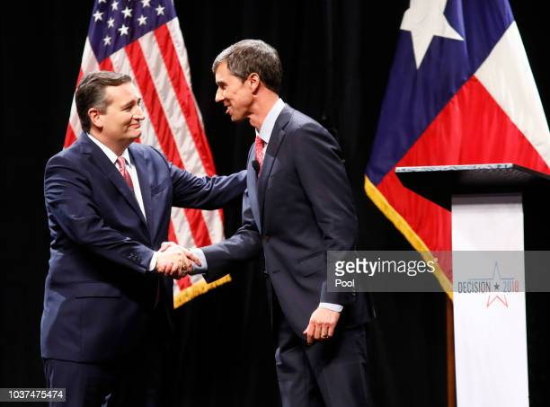 Sen Ted Cruz and Rep Beto O'Rourke shake hands after a debate at McFarlin Auditorium at SMU on September 21 2018 in Dallas Texas