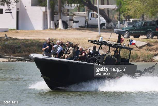Sen. Ted Cruz and Sen. Lindsey Graham stand aboard a Texas Department of Public Safety boat for a tour of part of the Rio Grande river on March 26,...