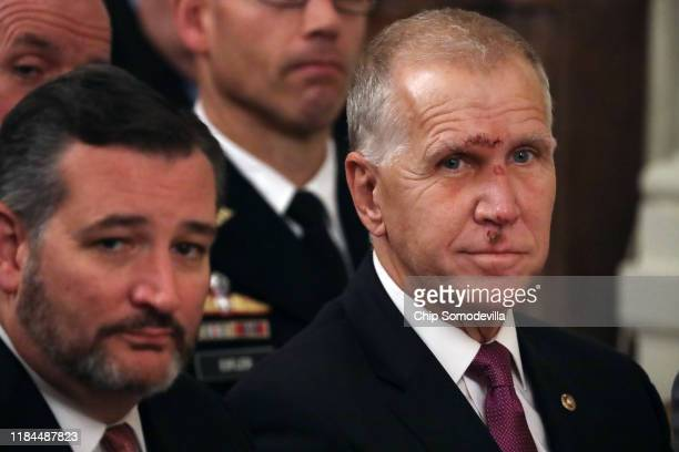 Sen Ted Cruz and Sen Thom Tillis attend the Medal of Honor ceremony for US Army Master Sgt Matthew Williams of Boerne Texas in the East Room of the...