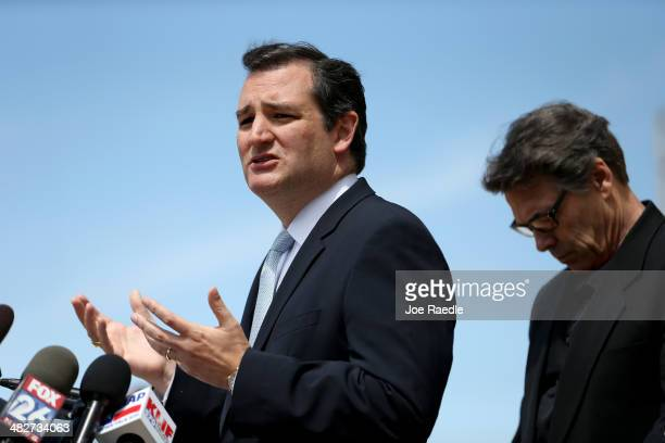 Sen Ted Cruz and Texas Governor Rick Perry speak to the media during a press conference at the front gate of Fort Hood about Iraq war veteran Ivan...