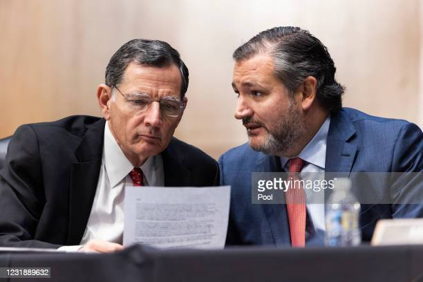 Sen. Ted Cruz chats with Sen. John Barrasso as they question former US Ambassador to the United Nations Samantha Power as she testifies before the...
