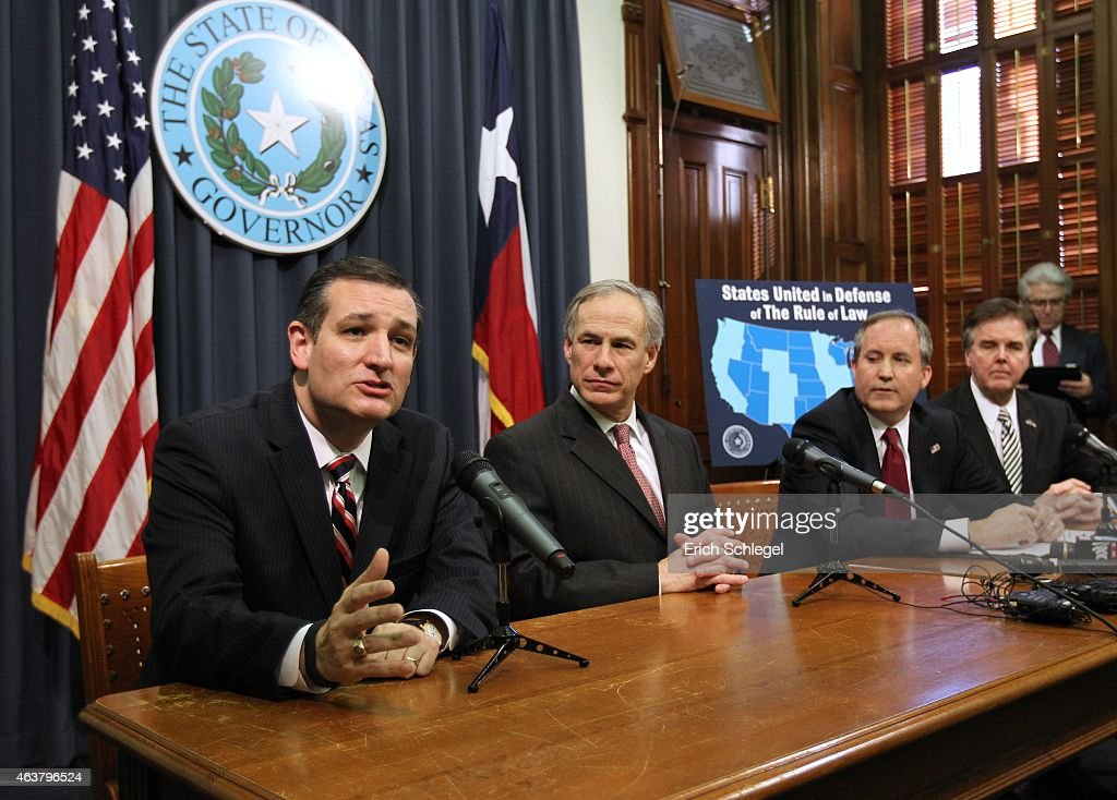 U.S. Sen. Ted Cruz (R-TX), Governor Greg Abbott, Attorney General Ken Paxton, Lieutenant Governor Dan Patrick hold a joint press conference February 18, 2015 in Austin, Texas. The press conference addressed the United States District Court for the Southern District of Texas' decision on the lawsuit filed by a Texas-led coalition of 26 states challenging President Obama's executive action on immigration.