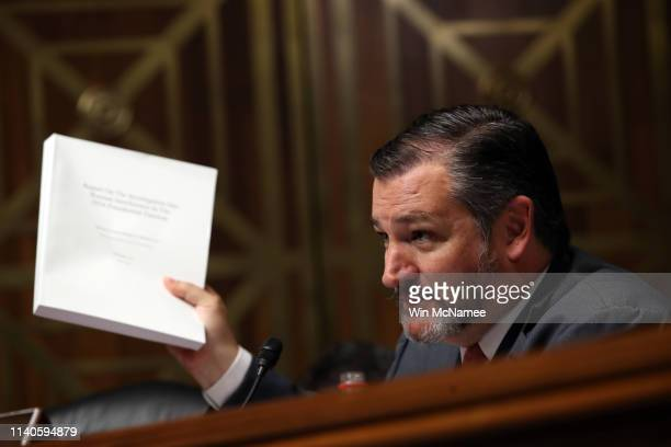 Sen Ted Cruz holds the Mueller report while asking the US Attorney General William Barr questions during the Senate Judiciary Committee hearing May 1...