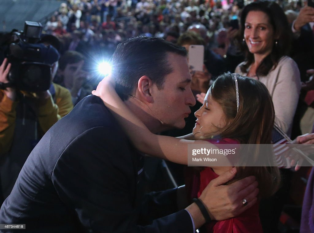 U.S. Sen. Ted Cruz (R-TX) kisses his daughter Caroline Cruz before walking onstage to speak at Liberty University to announce his presidential candidacy March 23, 2015 in Lynchburg, Virginia. Cruz officially announced his 2016 presidential campaign for the President of the United States during the event.