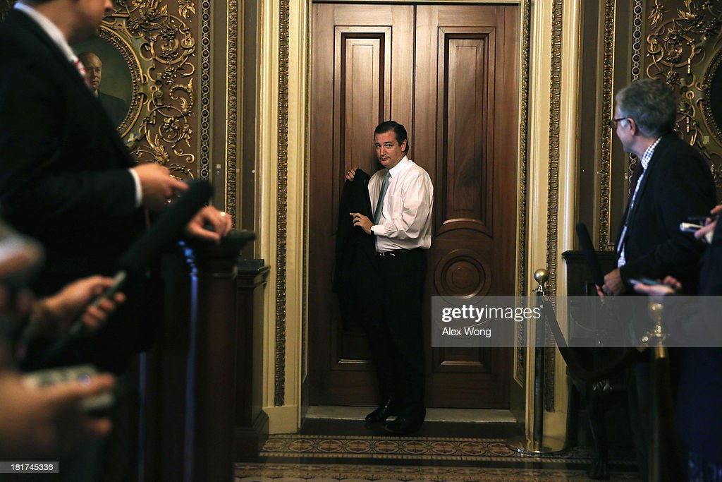 U.S. Sen. Ted Cruz (R-TX) leaves after the weekly Senate Republican Policy Committee luncheon September 24, 2013 on Capitol Hill in Washington, DC. Sen. Cruz is leading an effort in the Senate to defund Obamacare.