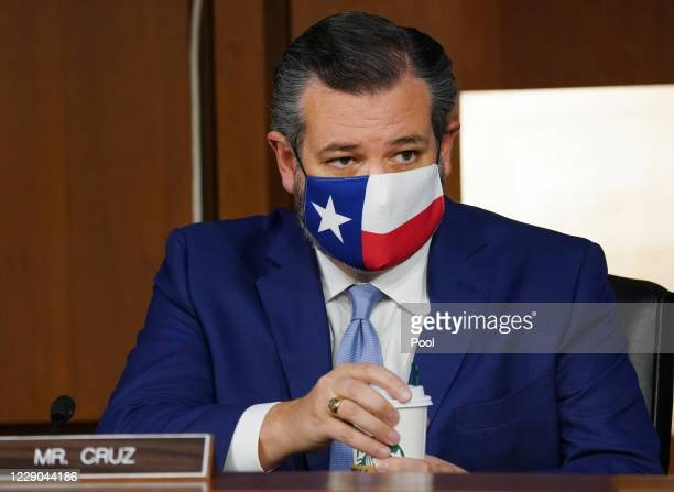 Sen. Ted Cruz listens as Supreme Court nominee Judge Amy Coney Barrett testifies before the Senate Judiciary Committee on the second day of her...