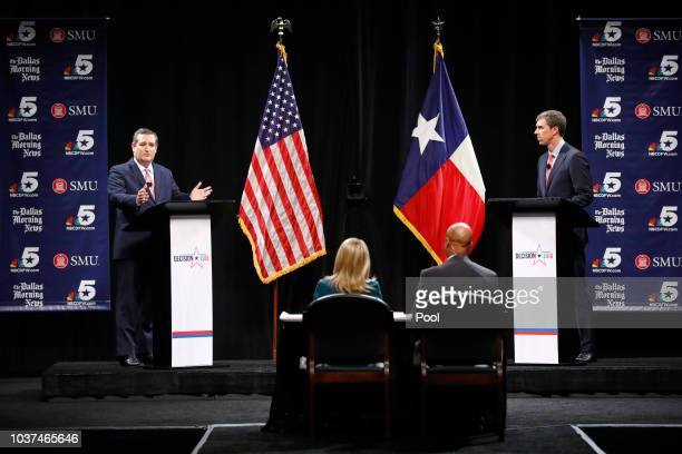 Sen Ted Cruz makes a comment as Rep Beto O'Rourke waits his turn during a debate at McFarlin Auditorium at SMU on September 21 2018 in Dallas Texas