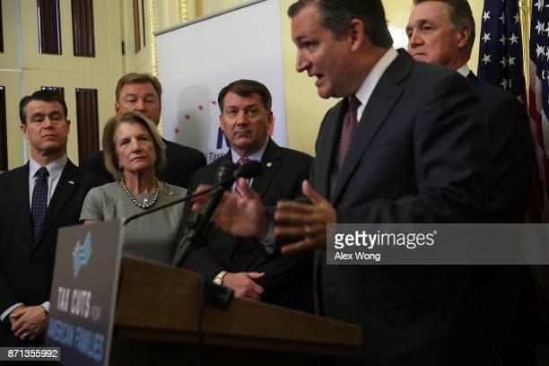 S Sen Ted Cruz speaks as Sen Todd Young Sen Shelley Moore Capito Sen Dean Heller Sen Michael Rounds and Sen David Perdue listen during a news...
