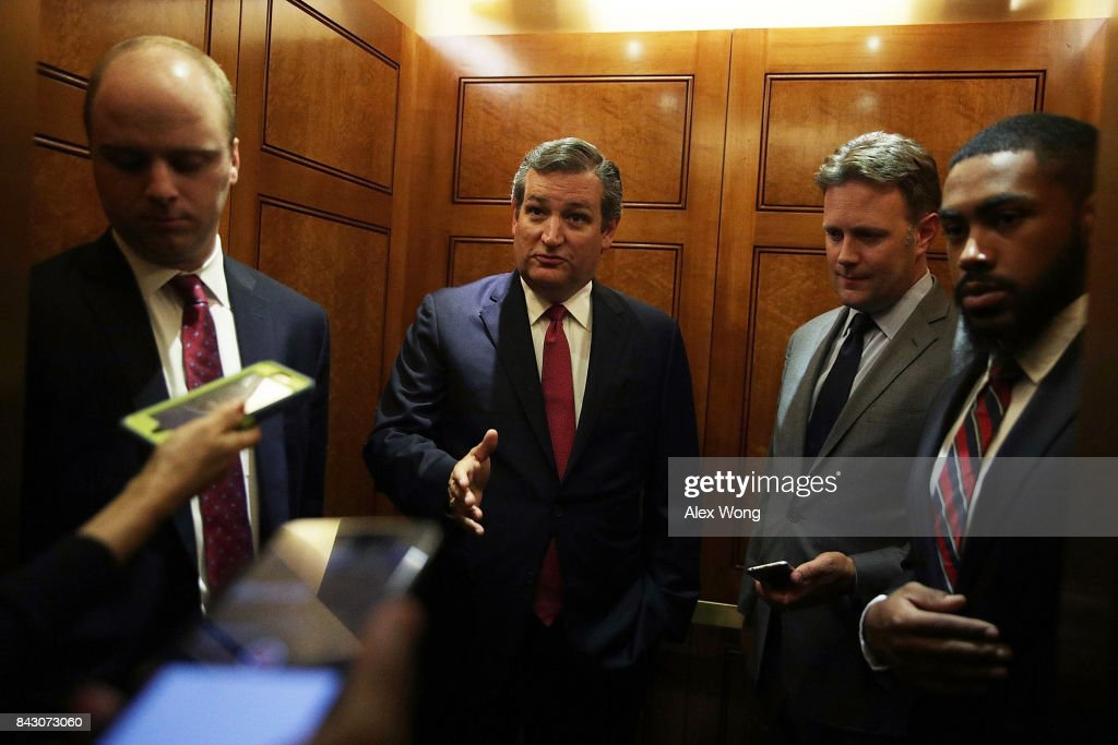U.S. Sen. Ted Cruz (R-TX) (2nd L) speaks to members of the media as he leaves after a vote at the Capitol September 5, 2017 in Washington, DC. Congress is back from summer recess with a heavy legislative agenda in front of them.