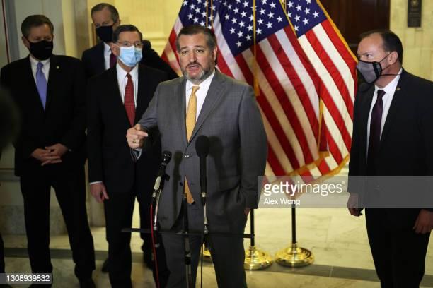 Sen. Ted Cruz speaks to members of the press as Sen. Steve Daines , Sen. John Thune , Sen. John Barrasso and Sen. Mike Lee listen after a Senate...