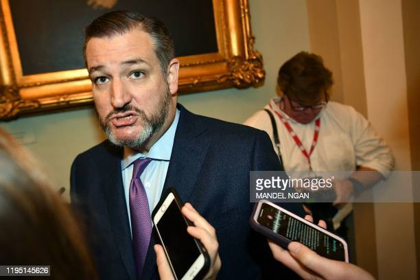 Sen Ted Cruz speaks to reporters as he arrives for the Senate impeachment trial of US President Donald Trump at the US Capitol in Washington DC...