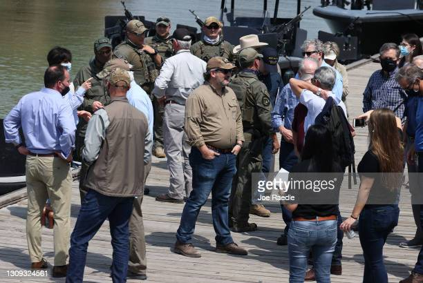 Sen. Ted Cruz stands with other Senators after taking a tour of part of the Rio Grande river on a Texas Department of Public Safety boat on March 26,...
