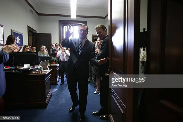 S Sen Ted Cruz waves from his office at the Senate Russell Office Building as he is about to close the door after he spoke to members of the media...