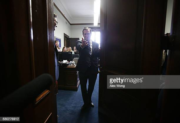 S Sen Ted Cruz waves to an unidentified person from his office at the Senate Russell Office Building after he spoke to members of the media May 10...