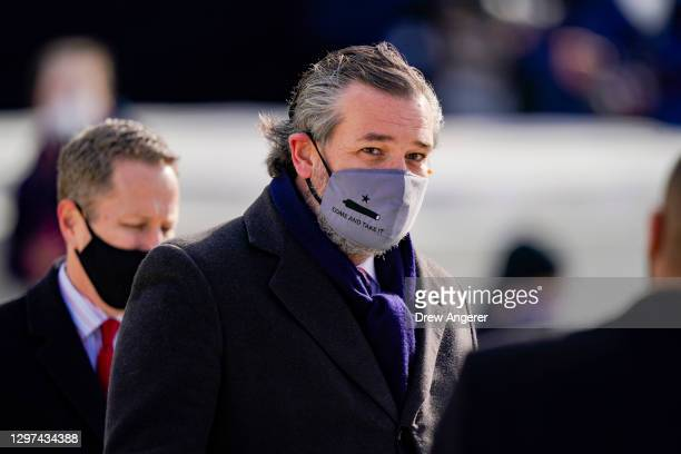 """Sen. Ted Cruz , wearing a face mask that reads """"Come and Take It"""", arrives to the inauguration of U.S. President-elect Joe Biden on the West Front of..."""