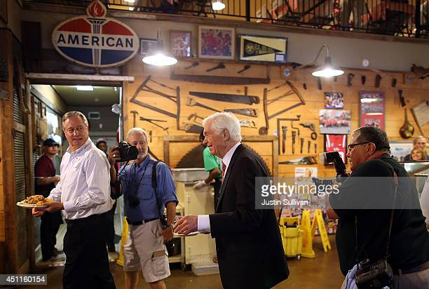 S Sen Thad Cochran is pursued by news photographers as he prepares to eat lunch at Mama Hamil's restaurant on June 24 2014 in Madison Mississippi US...