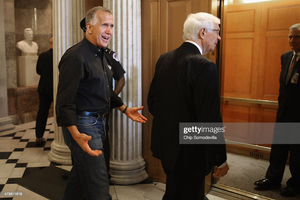 Sen. Thom Tillis (R-NC) (L) jokes with reporters after walking off the Senate floor in jeans and a casual shirt with Sen. Thad Cochran (R-MS) at the U.S. Capitol May 18, 2015 in Washington, DC. Senate Majority Leader Mitch McConnell (R-KY) said that he will postpone the Senate's Memorial Day recess until lawmakers tackle a trade bill, renewal of the Patriot Act and funding for federal highways.