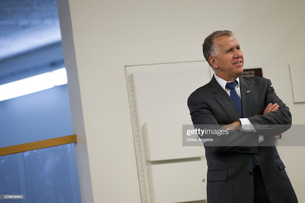 Sen. Thom Tillis (R-NC) speaks with an aide after a vote at the U.S. Capitol, May 9, 2016, in Washington, DC. Senate Democrats defeated a procedural vote on an energy bill, which increases funding for the Department of Energy and Army Corps of Engineers.