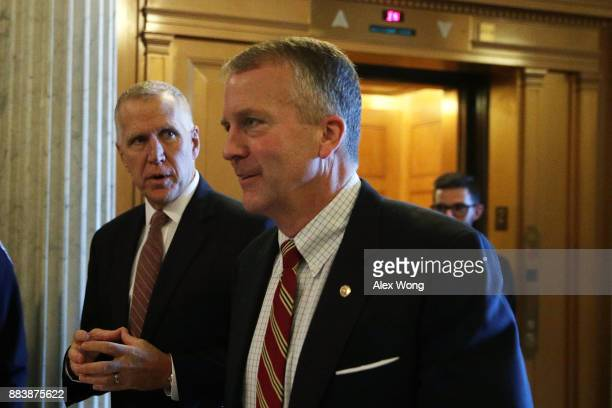 S Sen Thom Tillis walks with Sen Daniel Sullivan at the Capitol December 1 2017 in Washington DC Senate GOPs indicate that they have enough votes to...