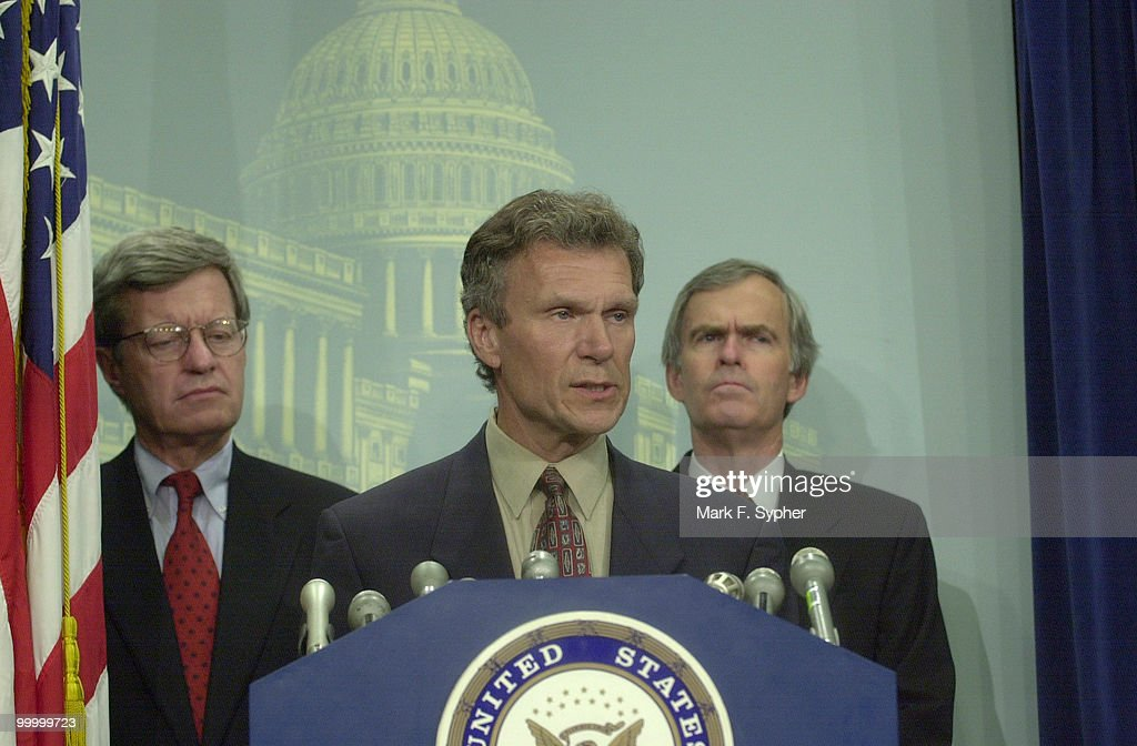 Sen. Thomas A. Daschle (D-SD), address the media at a press conference concerning trade authority. Accompanying him are Senators Max S. Baucus (D-MT), and Jeff Bingaman (D-NM).